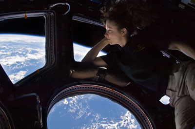 Astronaut Tracy Caldwell Dyson enjoying a view from the ISS Cupola window.