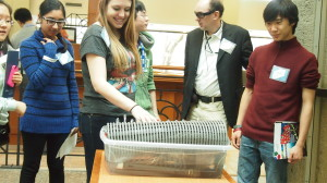 Delegates at Science Expo 2013 play with the Hydraulophone, a liquid instrument invented by Dr. Steve Mann.