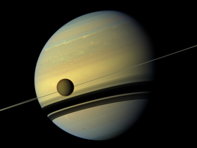 Titan against Saturn. Credit: NASA