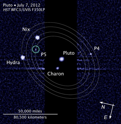 This image, taken by the NASA/ESA Hubble Space Telescope, shows five moons orbiting Pluto, the distant, icy dwarf planet (ESA/Hubble/AFP/Showalter)