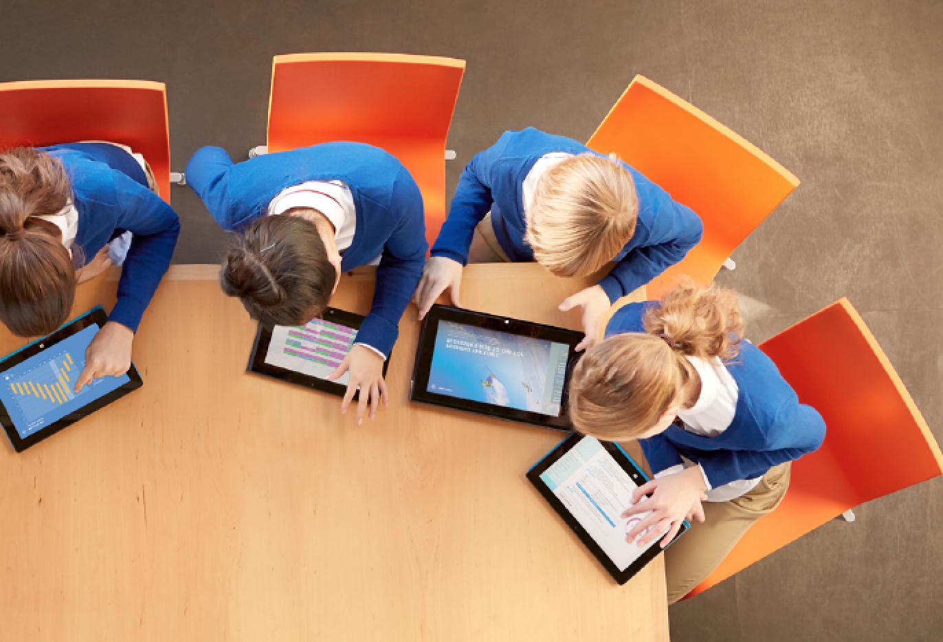 education kids on tablets